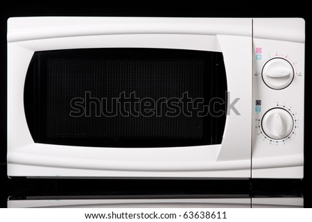Microwave oven. On black background.