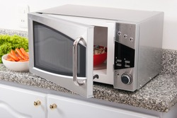 Microwave oven; photo in kitchen environment.