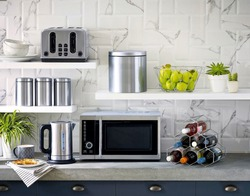Microwave the kitchenware home appliance isolated in the kitchen interior