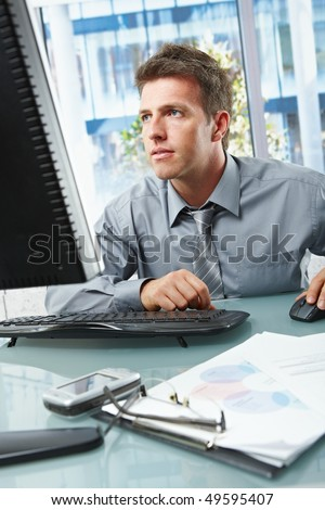 stock photo mid adult businessman concentrating on computer work at office desk looking at screen 49595407 Oiled Blonde Teen showing her round ass.