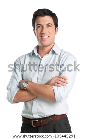 Mid adult businessman looking at camera with smiling and proud expression