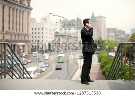 Mid adult businessman talking on a cell phone and gesturing with his hand. Photo stock ©