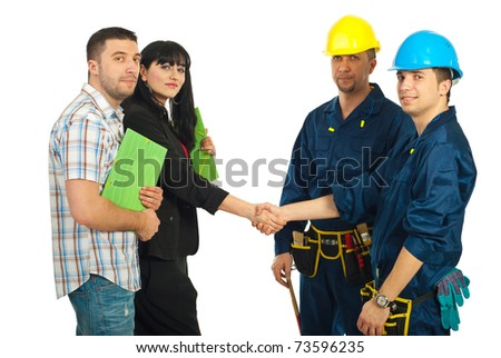 Mid adult couple and workers team having an agreement and gives hand shake over white background