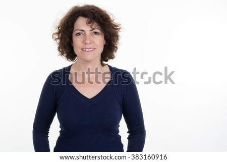 mid adult happy smiling woman portrait, caucasian middle aged 40 years old woman in coat and hat over blue #383160916