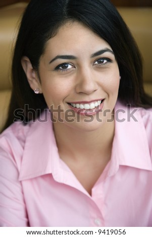 Mid adult Hispanic woman smiling at viewer.