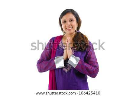 Mid Adult Indian woman in a greeting pose, isolated white background
