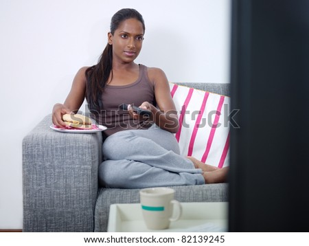 stock photo mid adult indian woman on sofa changing tv channel with remote control and eating junk food front 82139245 First, what is sex? Sex can mean a lot of different things to a lot of ...