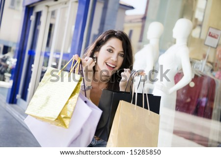Mid adult Italian woman holding shopping bags