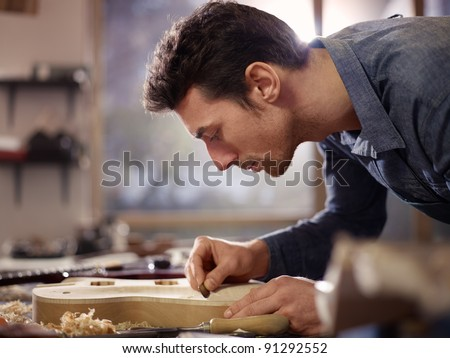 stock photo : mid adult man at work as craftsman in italian workshop with ...