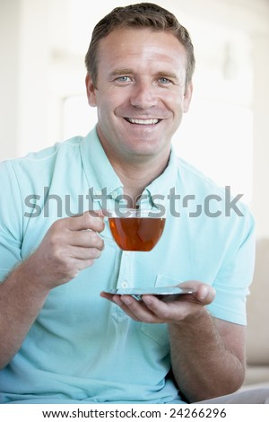 Mid Adult Man Drinking Tea