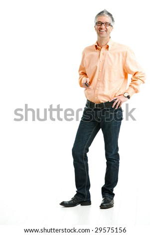 Mid-adult man wearing jeans and orange shirt standing and holding mobile phone. Isolated on white. - stock photo