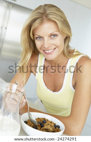 Mid Adult Woman Eating Cereal With Fruit