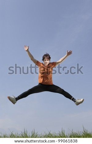 Mid adult woman jumping in the air
