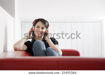 mid adult woman listening to music at home. Copy space