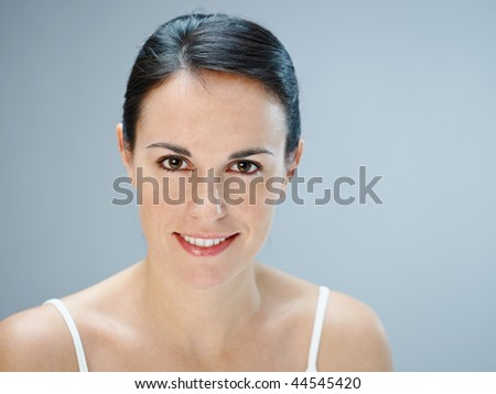 mid adult woman looking at camera. Copy space