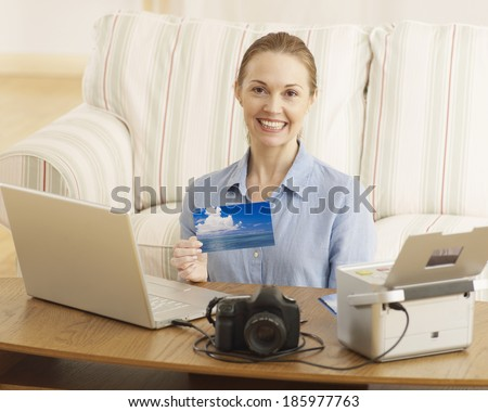 Mid-Adult Woman Printing Out Digital Photographs