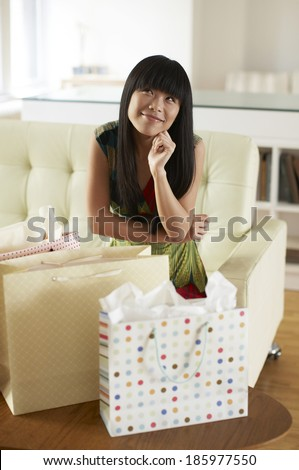 Mid Adult Woman with Shopping Bags Day Dreaming