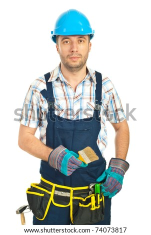 Mid adult worker man holding paint brush isolated on white background
