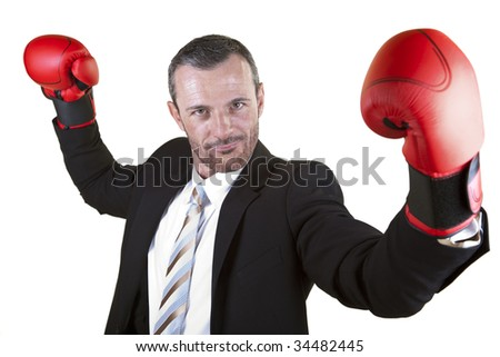 He wears boxing gloves .