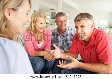 Mid age couples chatting at home #84043273