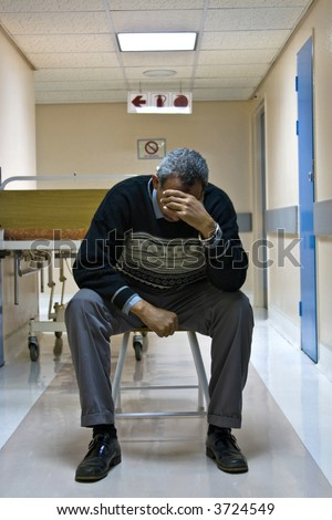 mid age man waiting on the hospital hallway for his wife after surgery, healthcare series