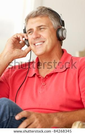 Mid age man wearing headphones