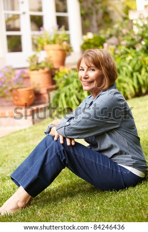 Mid age woman relaxing in garden