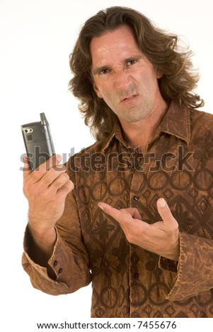 Mid-aged man with long hair apparently frustrated with his cell-phone