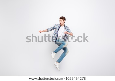Mid-air shot of mad, crazy, cheerful, successful guy with bristle jumping, looking to the side, posing, gesturing against white background #1023464278