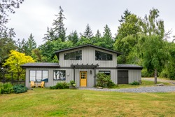 Mid-century modern cottage house in the woods. Exterior design.
