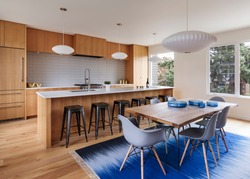 Mid-century modern kitchen with custom wood cabinets and blue accents. Portland, Oregon