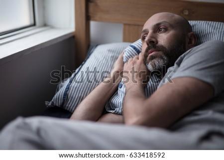 mid forties depressed man in...