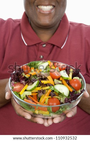 stock photo mid section of an obese man holding a bowl of salad isolated over white background 110932532 Clip 119345: Medium shot stock video of obese fat weight   HD 1920x1080, ...