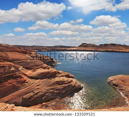 Midday heat. The artificial Lake Powell in the red desert of California.  Photo taken fisheye lens