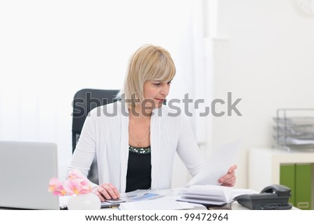 Middle age business woman working with documents