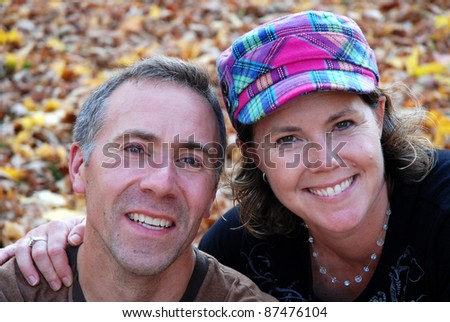 middle age couple in fall foliage