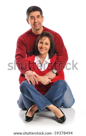 Middle age couple posing isolated on a white background