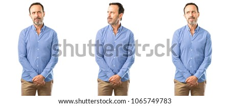Middle age handsome man doubt expression, confuse and wonder concept, uncertain future over white background #1065749783