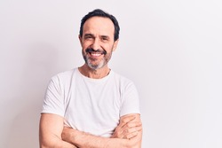 Middle age handsome man wearing casual t-shirt standing over isolated white background happy face smiling with crossed arms looking at the camera. Positive person.