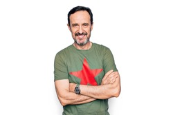 Middle age handsome man wearing t-shirt with revolutionary red star over white background happy face smiling with crossed arms looking at the camera. Positive person.