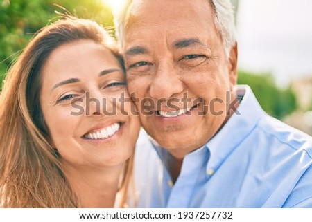 Middle age hispanic couple smiling happy hugging at the promenade. Сток-фото ©