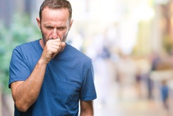 Middle age hoary senior man over isolated background feeling unwell and coughing as symptom for cold or bronchitis. Healthcare concept.