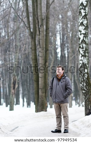 Middle age man walking in spring park
