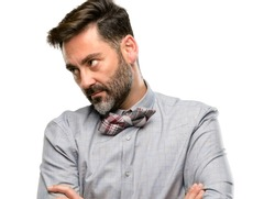 Middle age man, with beard and bow tie irritated and angry expressing negative emotion, annoyed with someone isolated over white background