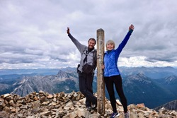 Middle age people on mountain top looking happy and successful. Hiking in British Columbia near Vancouver, BC. Mount Frosty in Manning Park. Hope. Coquihalla. Canada.