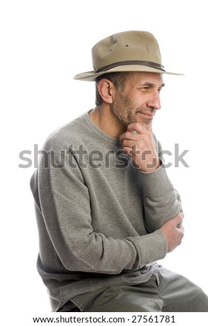 middle age senior man expressive face wearing thinking thought adventure hat