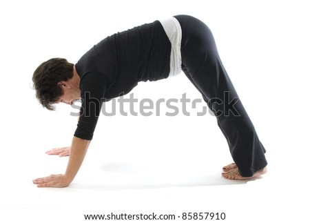 middle age senior woman yoga exercise position downward facing dog pose