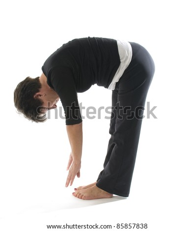 middle age senior woman yoga exercise position hamstring stretch toe touch