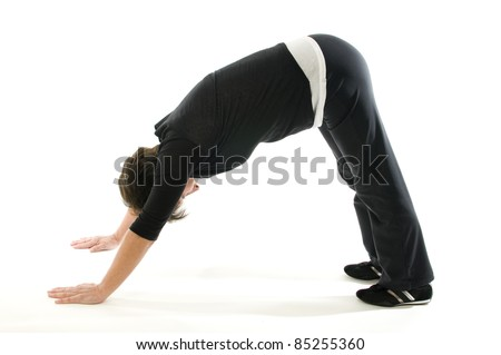 middle age senior woman yoga position downward dog exercise