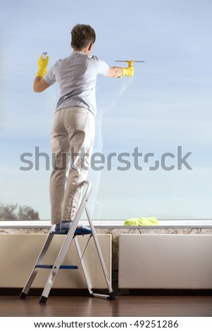 Middle Age Woman Cleaning the Window